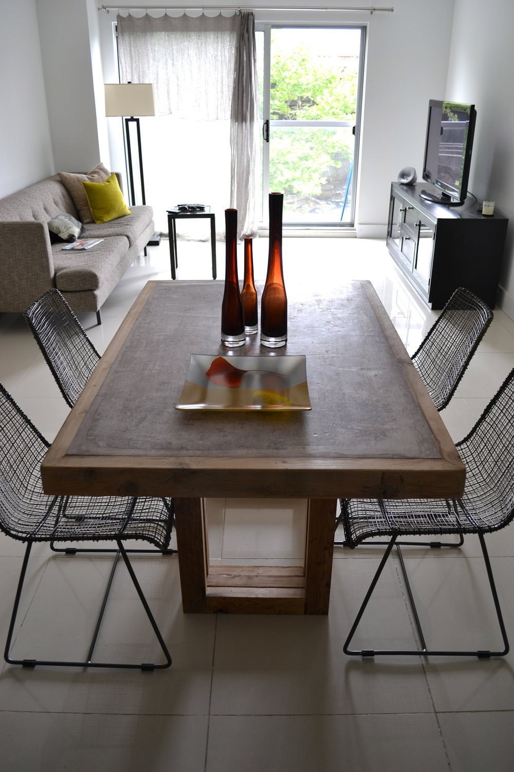 concrete dining table concrete and reclaimed wood table. Black Bedroom Furniture Sets. Home Design Ideas