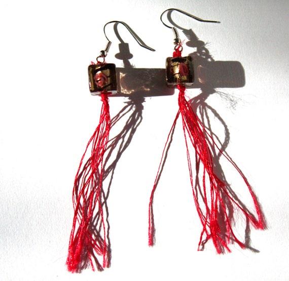 red yarn earrings