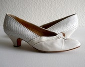 vintage 1960s designer pumps in white snake skin by Maud Frizon
