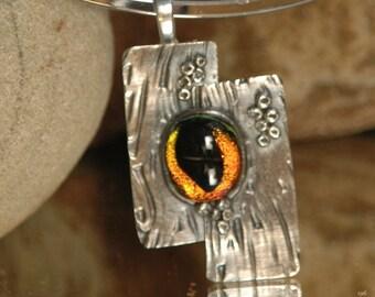 A sparkling Tigers Eye glass gemstone set into Fine Silver.