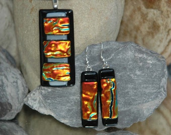 Fused Dichroic pendant and matching earrings in vibrant colours.