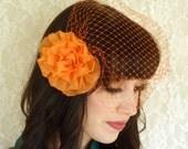 Orange Flower Hair Clip with Birdcage Veil