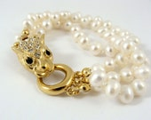 Multi strand freshwater pearl bracelet with gold and Swarovski crystal leopard clasp