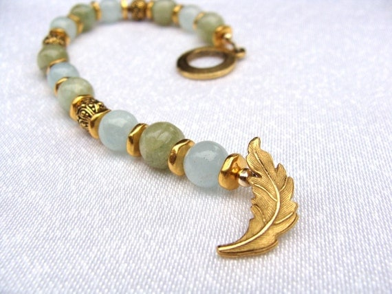 Bracelet in sage green and light blue semi precious stones with gold