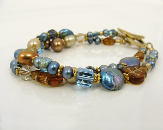 Pearl bracelet double strand with Swarovski crystals pearls and glass in caramel brown and blue
