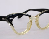 Vintage EyeGlasses Cat Eye Style. Great shape with carved Designs