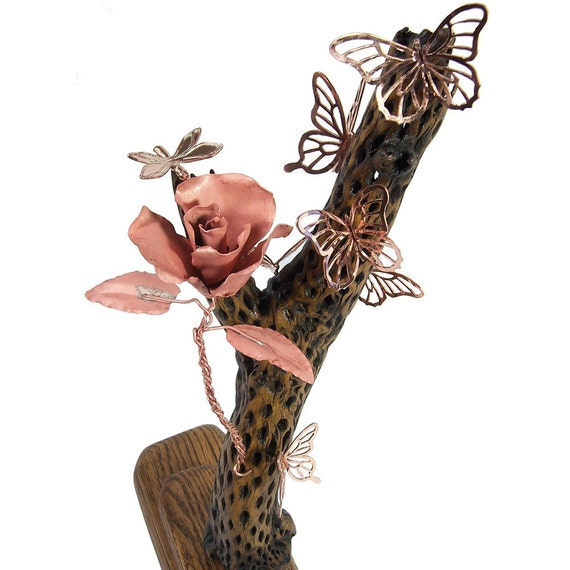 The Intruder, Butterfly Sculpture with a hornet and a rose