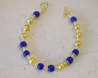 Dressy Bracelet in Dark Blue and Gold .... Fancy, Dressy, lovely bracelet and .99 US shipping