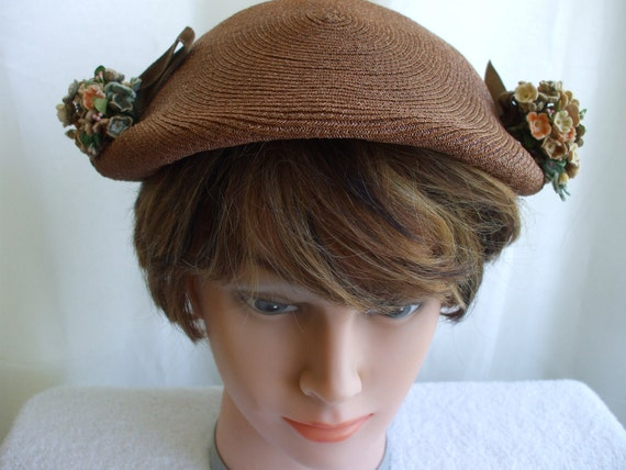 Brown Straw Hat with velvet ribbon and flowers on each side.  1940/50's
