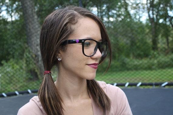 Black nerd glasses, with light blue hearts.