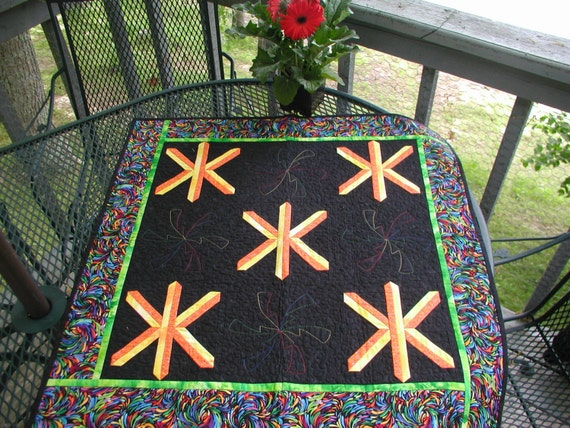 Fireworks 31 inch quilted table centerpiece of starbursts on black