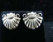 Sterling Silver shell earrings with genuine diamonds