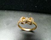 Adorable 14k Gold diamond studded bow ring