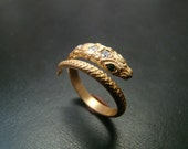 14k Gold amazingly detailed snake ring with diamonds and emerald eyes.