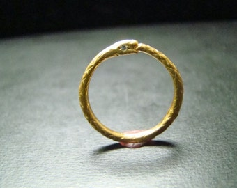 14k gold thin snake band with diamond eyes
