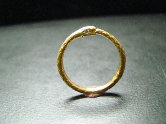 14k gold thin snake band with diamond eyes