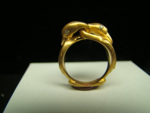 Romantic 14k Gold double swan ring with diamonds
