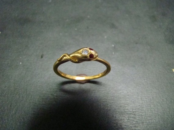 sweet 14k gold snake ring with and ruby