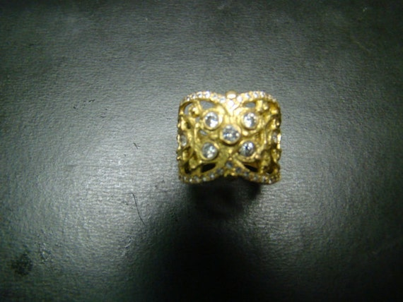 Magnificent 18K gold and diamond cigar band ring