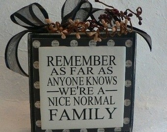 REMEMBER - As Far As Anyone Knows We're A Nice, Normal Family - vinyl saying on wood block with berries on top