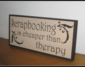 Scrapbooking is Cheaper Than Therapy.  Hand Painted Wooden Sign