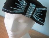Customised vintage black pillbox hat with blue crystaled bow