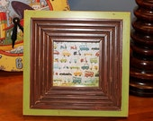 Green painted frame with chocolate brown distressed trim
