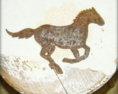antique rusty metal horse silhouette by montanasnowvintage