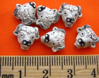 4 Tiny White Buffalo Head Beads