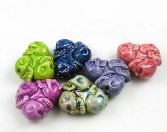4 Tiny Skull Wheel Beads - mixed colors - CB782