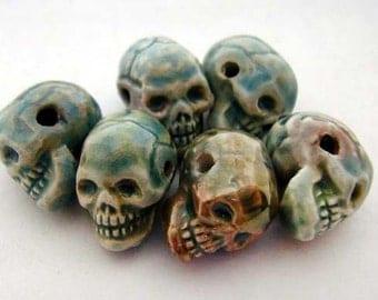 20 Tiny Raku Skull Beads - horizontal holes - CB572