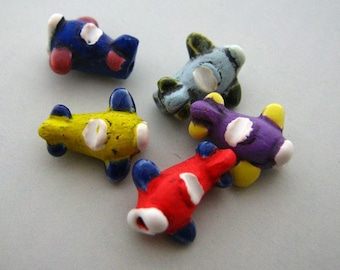 4 Tiny Airplane Beads - CB213