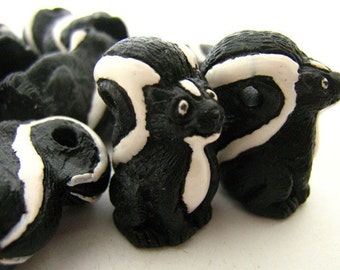 4 Large Skunk Beads - LG107