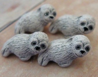 4 Tiny White Seal Pup Beads