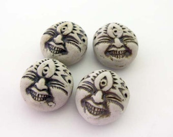 4 High Fired Face Beads