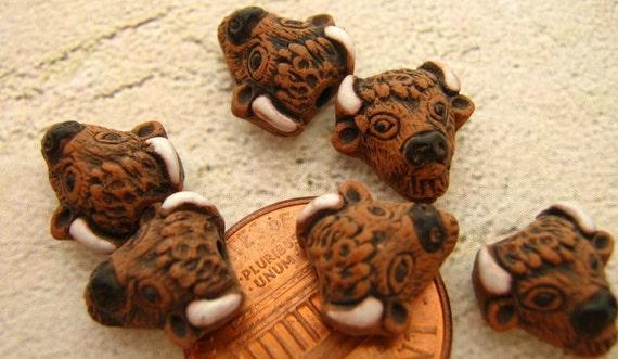 4 Tiny Buffalo Head Beads - CB254