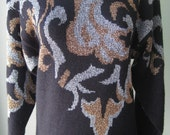 Rochelle - black knit sweater - gold and silver pattern - totally 80 - 1980 - size medium - rock ability - Dallas and dollars, miami vice.