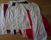 vintage slip lot - eleven pieces - medium - large - under garment - 1950 style - five white - one off white - one pink - one black - two red - one burgundy - lace - nylon - skirt slip.