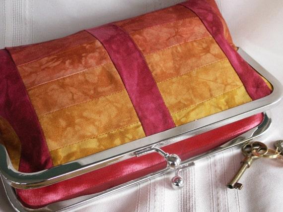 Handmade, hand dyed, patchwork clutch handbag. Red, orange, gold, yellow. SUNRISE by Lella Rae on Etsy