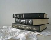 Vintage book trio in basic black, hardcover books