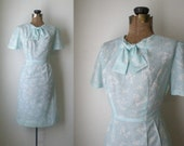 vintage 1950s wiggle dress II vintage 50s Bluebelle light blue cotton floral wiggle dress with bow tie