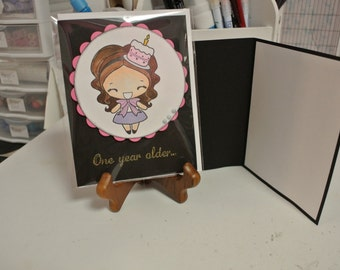 One year older girl with birthday cake greeting card