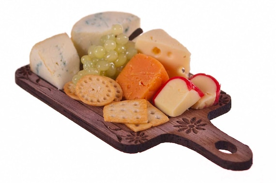 assorted cheese grapes and craker board  miniature food