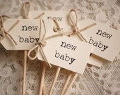 New Baby Party Picks - cream with twine bows - set of 10