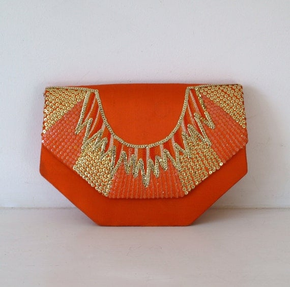 Vintage 1970s orange satin evening clutch bag with geometric art deco style sequin beading by Lords