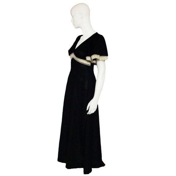 Vintage 1970s lace trimmed black crimplene maxi dress with flutter sleeves size medium