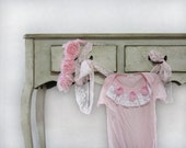 Baby girl onesie adorned with lace in vintage style