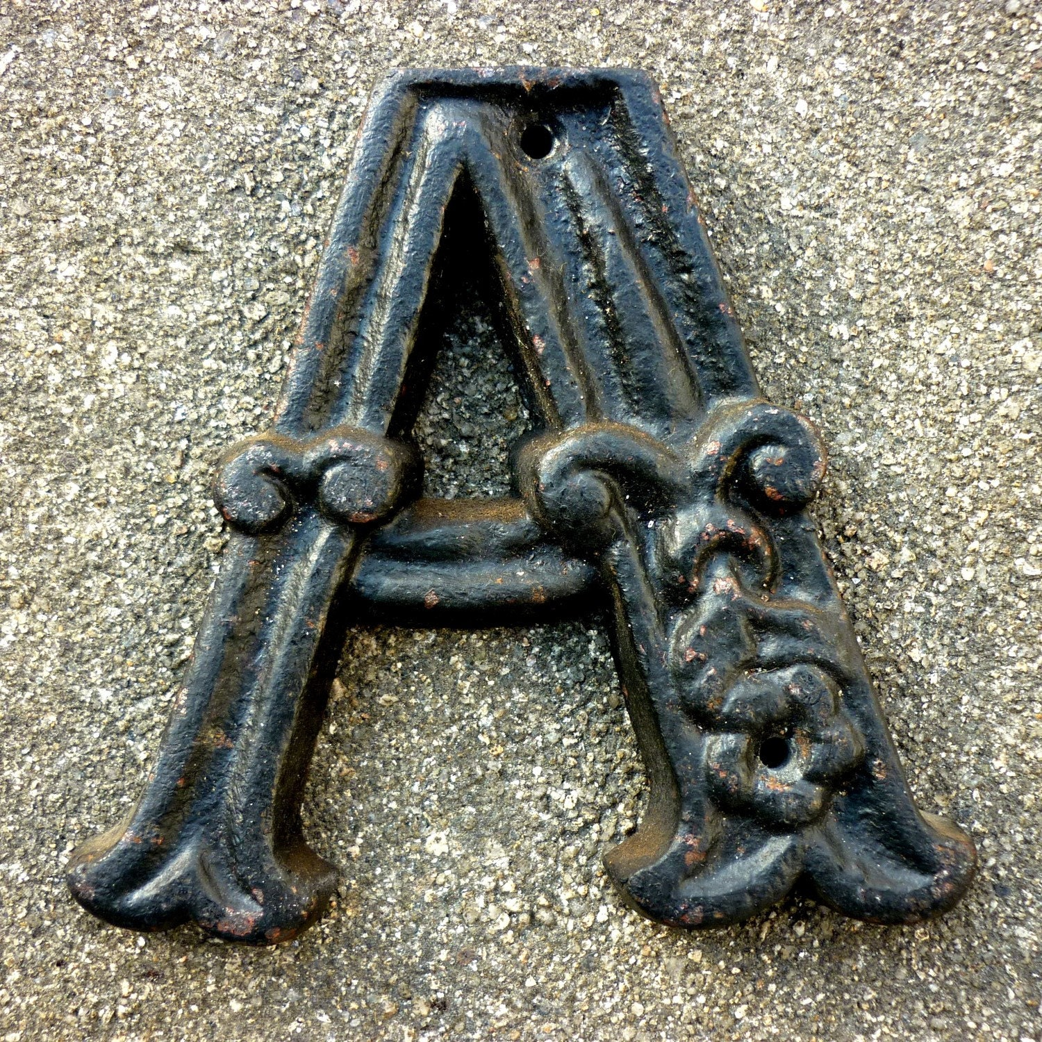 vintage letter cast iron zoom