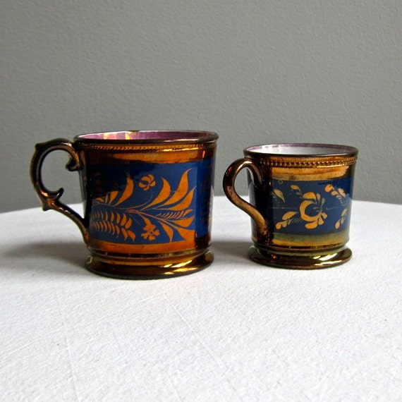 Two Copper Lustre Pottery Mugs with Cobalt Decoration, English, 19th century