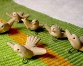 two dozen clay dove beads